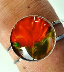 bracelet . Silver plated nickle free metal wrist band and bezel, ENCAUSTIC PAINTING ORIGINAL (red poppy) protected with clear glass cabochon